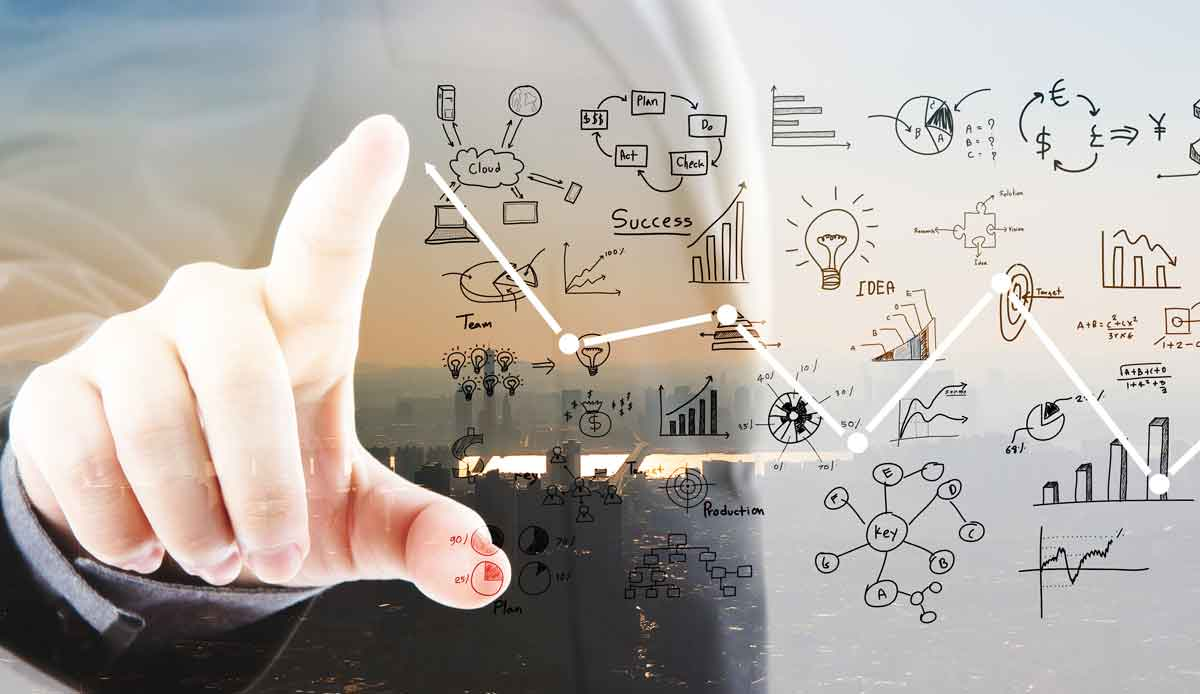 businessman pointing graphs and symbols