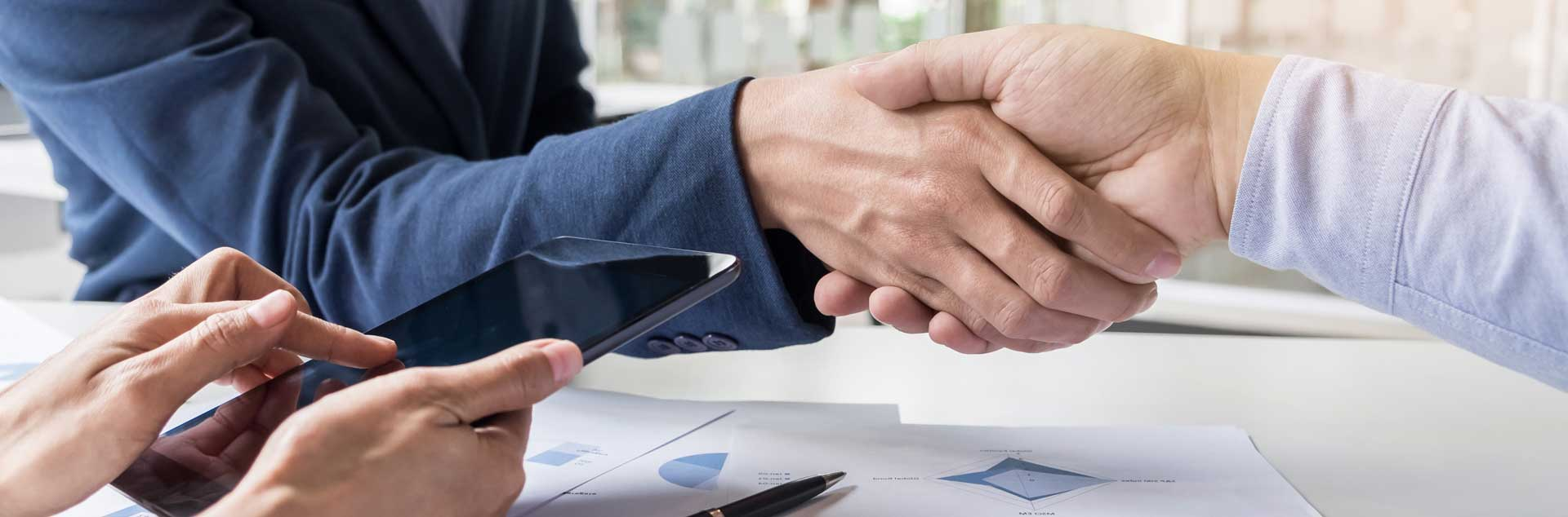 in raise business handshake of two men demonstrating their agreement to sign agreement or contract between their firms companies enterprises