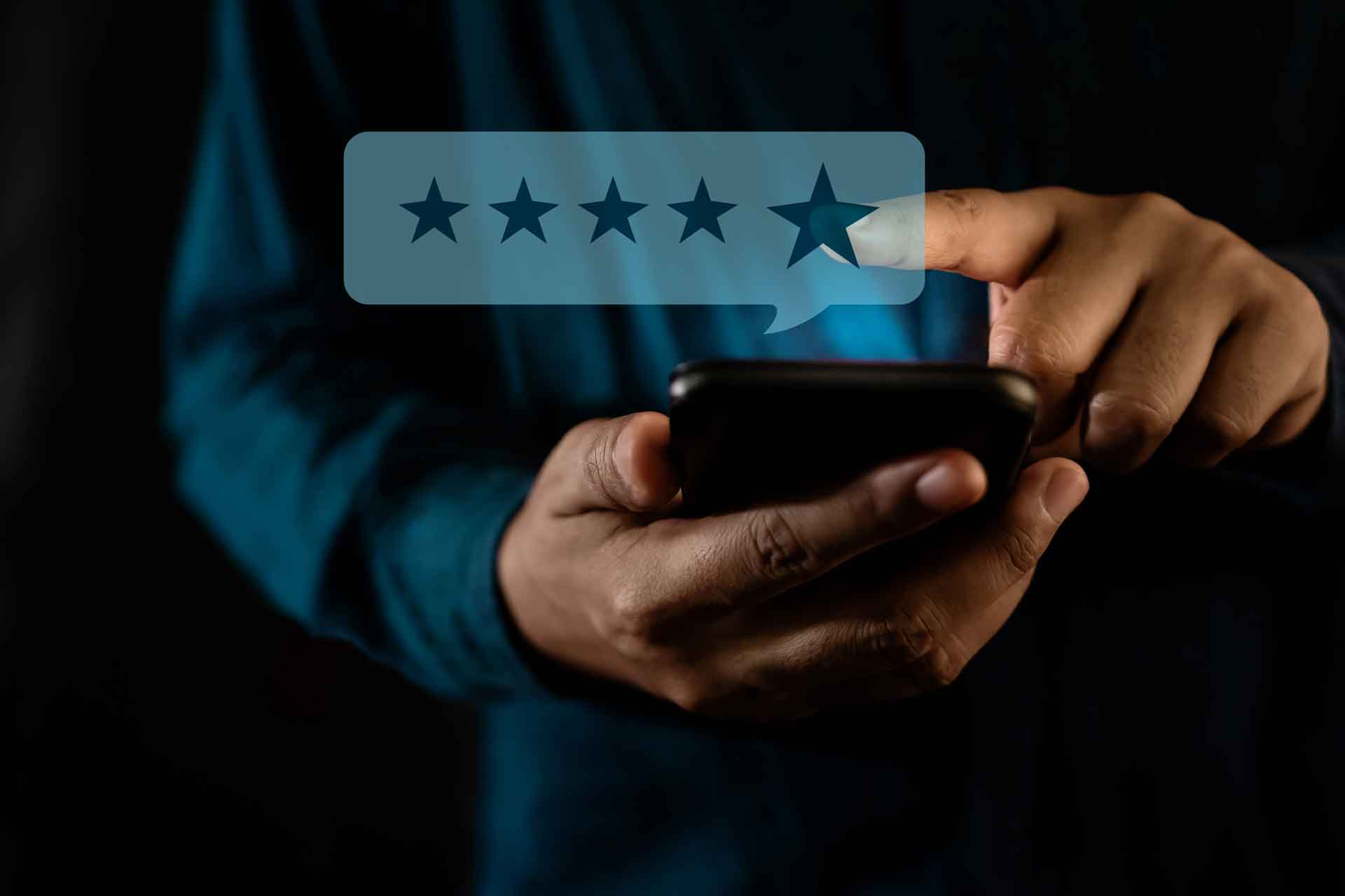 benefits of using wordpress for business modern man giving star rating positive review via smartphone