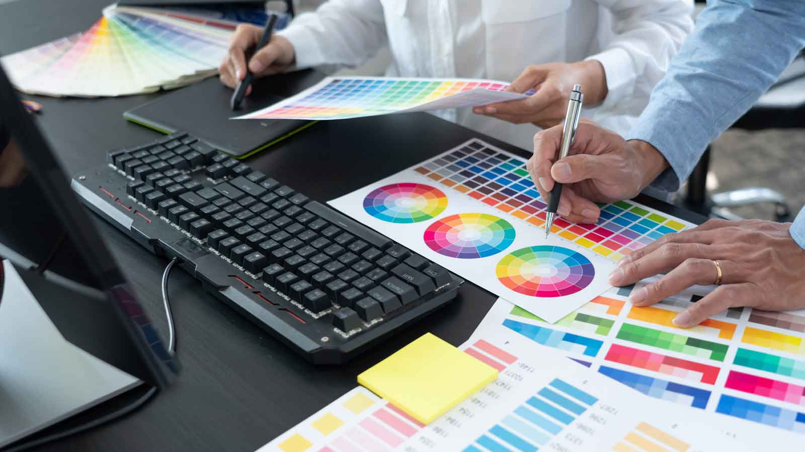 in raise design studio why you want a cugraphic designer team working web design using color swatches editing artwork using tablet stylus desks creative office
