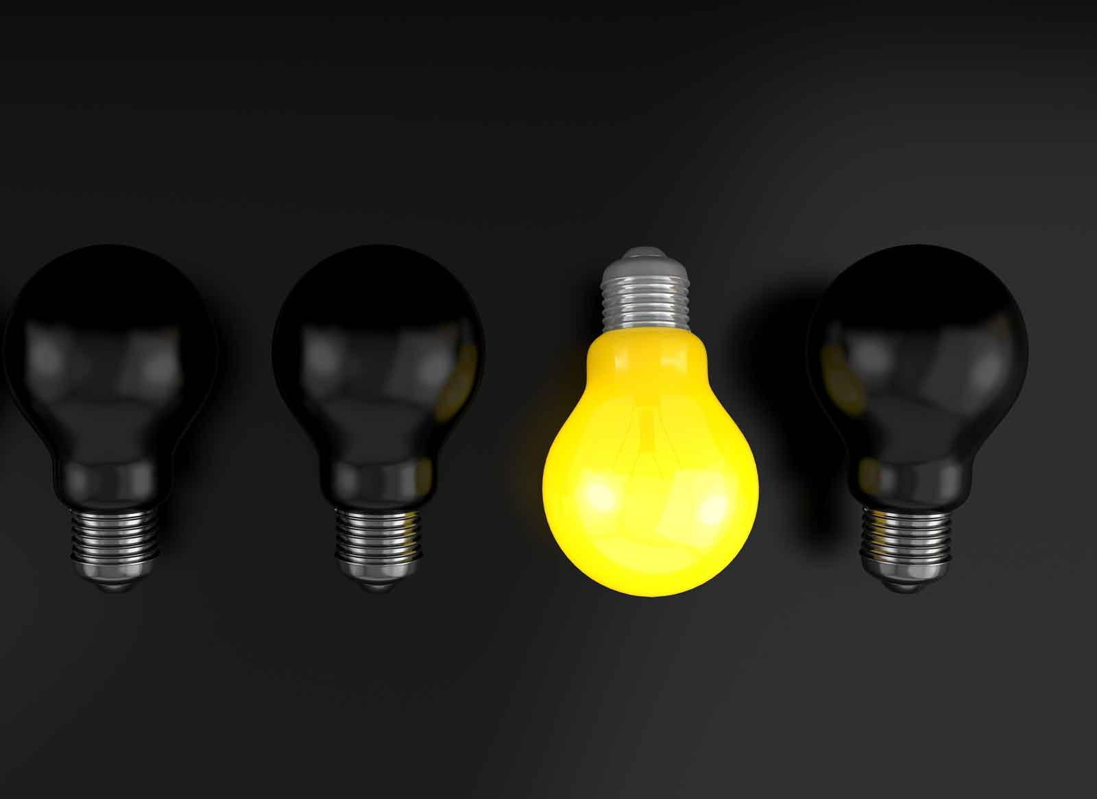 in raise design studio why you want a custom designed website lightbulb black background