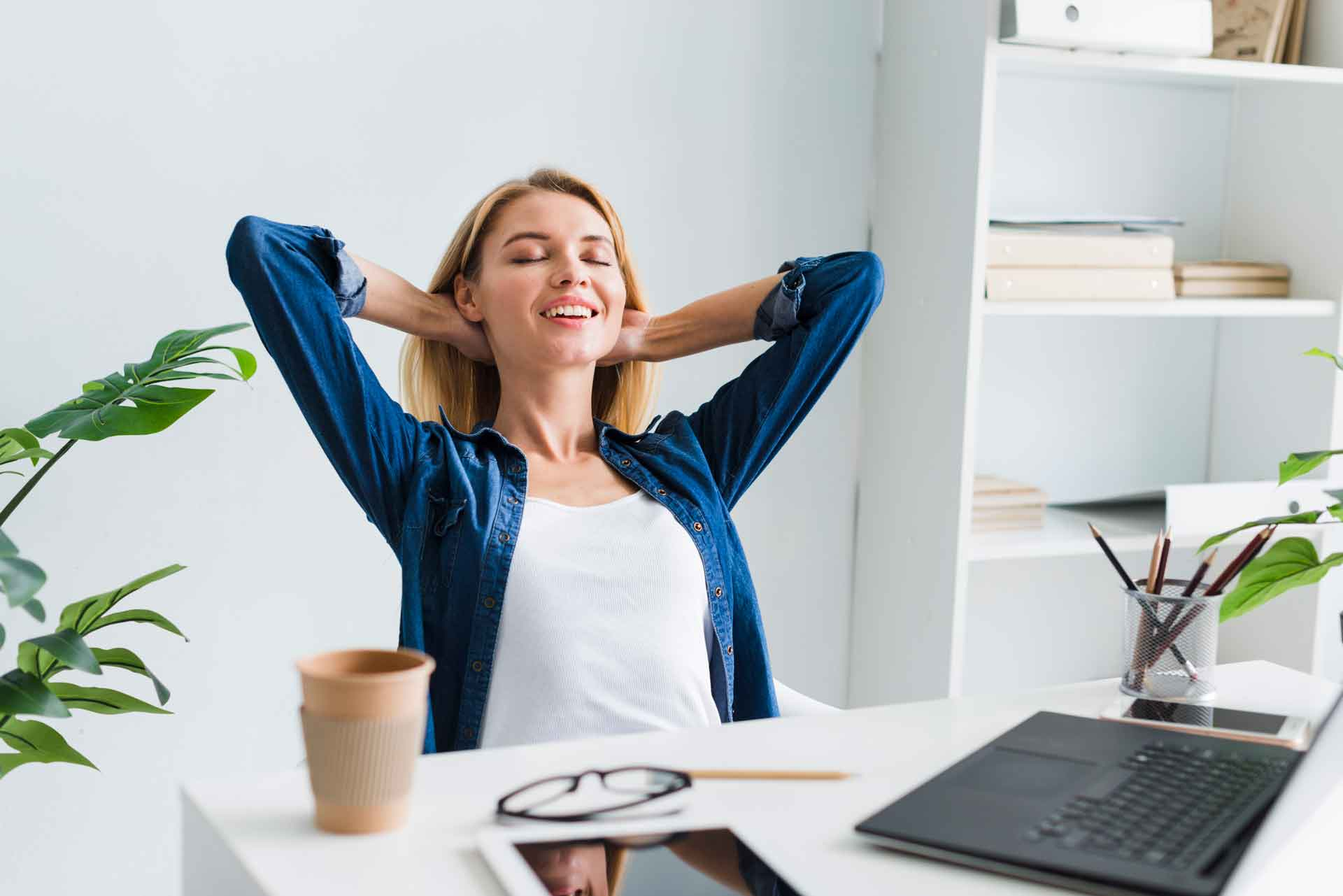 in raise design studio why you want a custom designed websiteblond woman sitting back smiling with closed eyes workplace